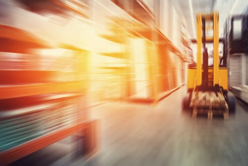 Warehouse interior with forklift.